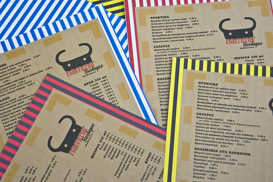 The final menu production, printed on brown craft paper, stuck on multi-colored striped card.